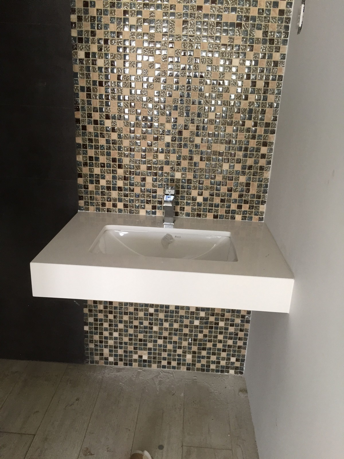 . Bathroom sink under mounted silestone blanco zues with skirt   The