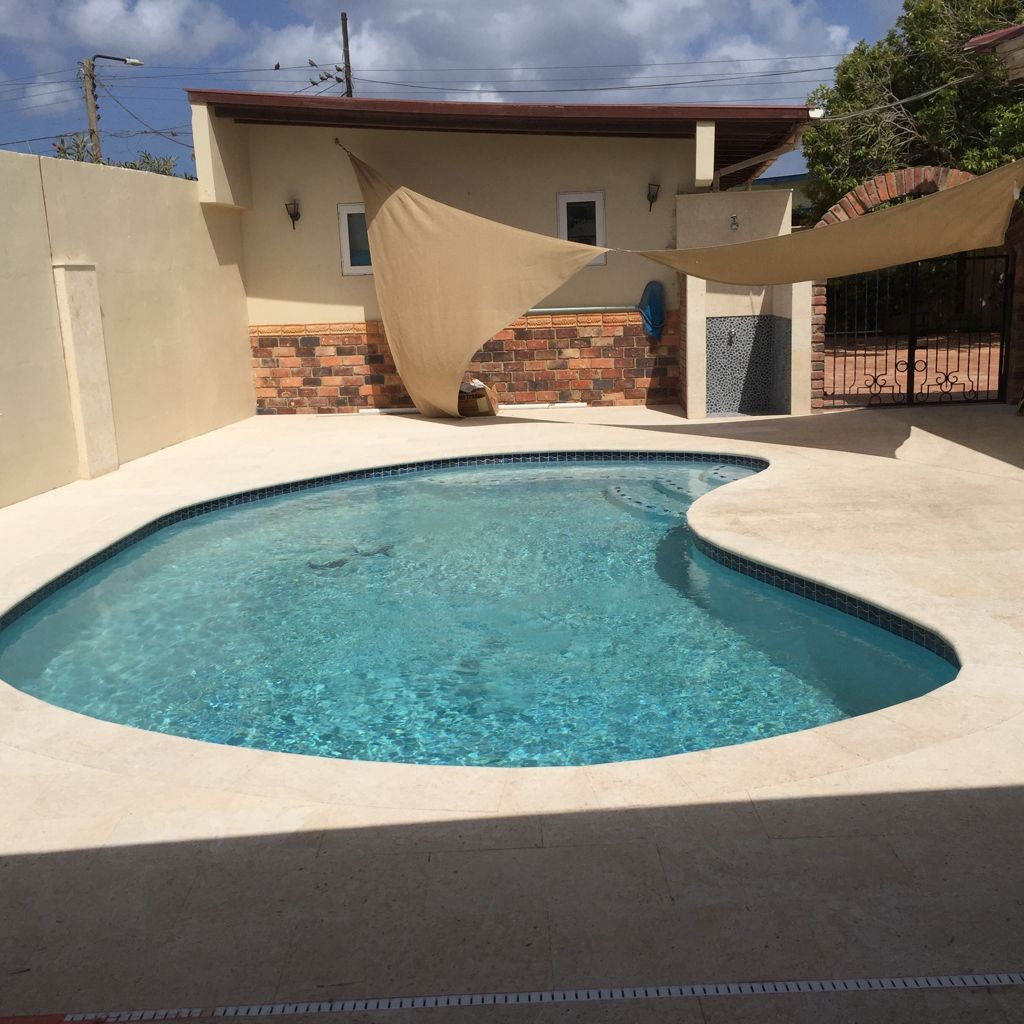 how to build a pool with stone deck